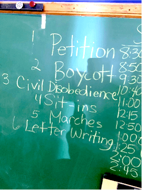 Chalkboard list shows 1 Petition, 2 Boycott, 3 Civil Disobedience, 4 Sit-ins, 5 Marches, 6 Letter Writing
