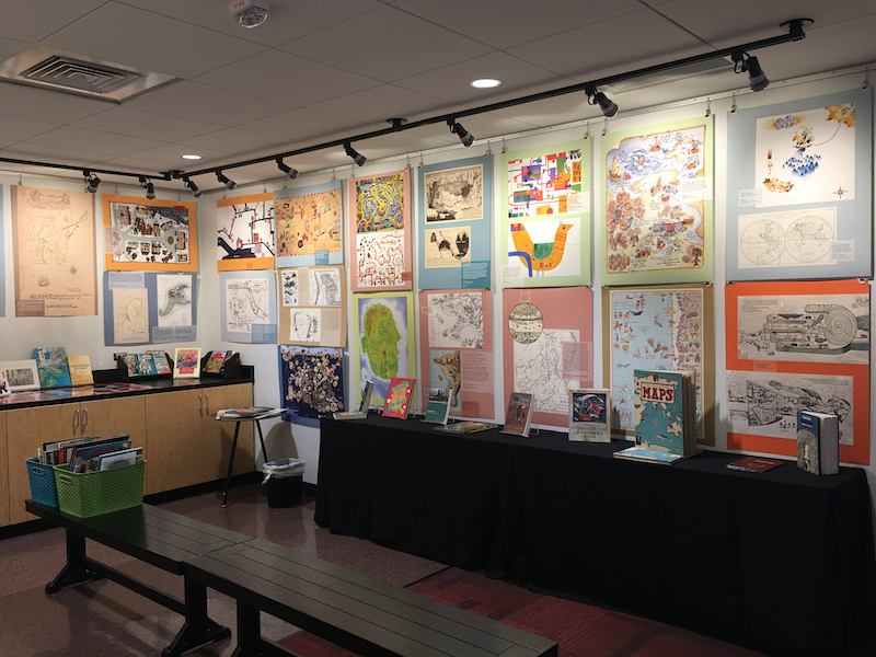 This photo shows the second half of the posters and books from the exhibit and includes additions to the exhibit from the WOW Center.