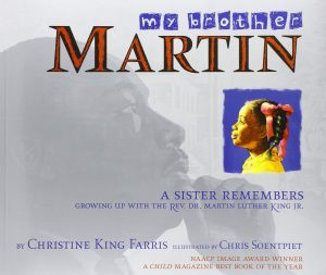Cover of My Brother Martin depicting a young Black girl in yellow looking at a faded image of Martin Luther King Jr.