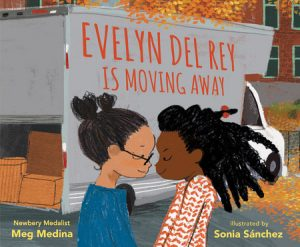 Cover of Evelyn del Rey is Moving Away depicting two young girls, one Hispanic and one Black, facing each other with smiles in front of a moving truck.