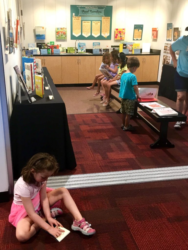 Groups of children read visual narratives in WOW's studio