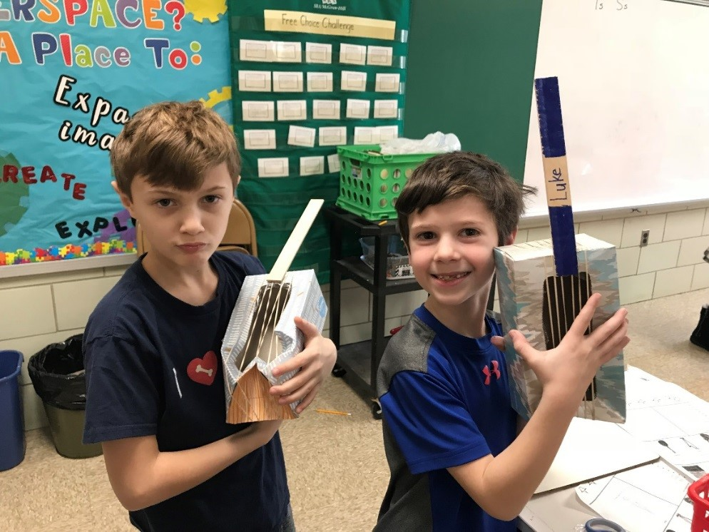 Jacob and Luke chose tissue boxes, paint sticks and rubber bands for their string instrument