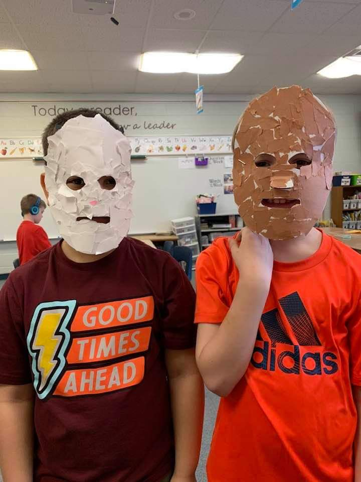 Second-grade students wearing their masks