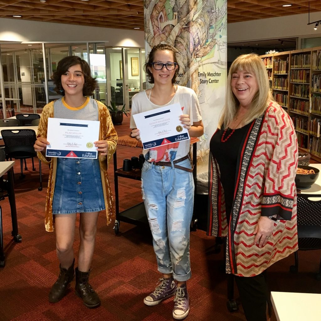 Two WOW Teen Reading Ambassadors receive certificates from Dr. Kathy Short