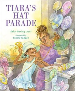 Cover of Tiara's Hat Parade depicting a young black girl smiling with a blue hat on her head as her mother smiles down at her while making a green hat.