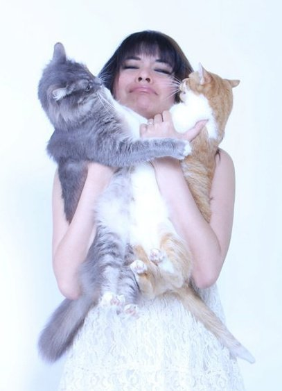 Yasmine Surovec with her cats.
