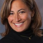 smiling portrait of Beth Ferry in black turtle neck shirt