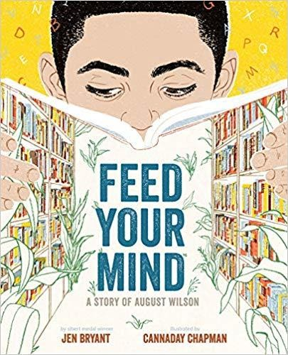Cover of Feed Your Mind depicting a young boy reading a book, the cover showing bookshelves filled with colorful books.