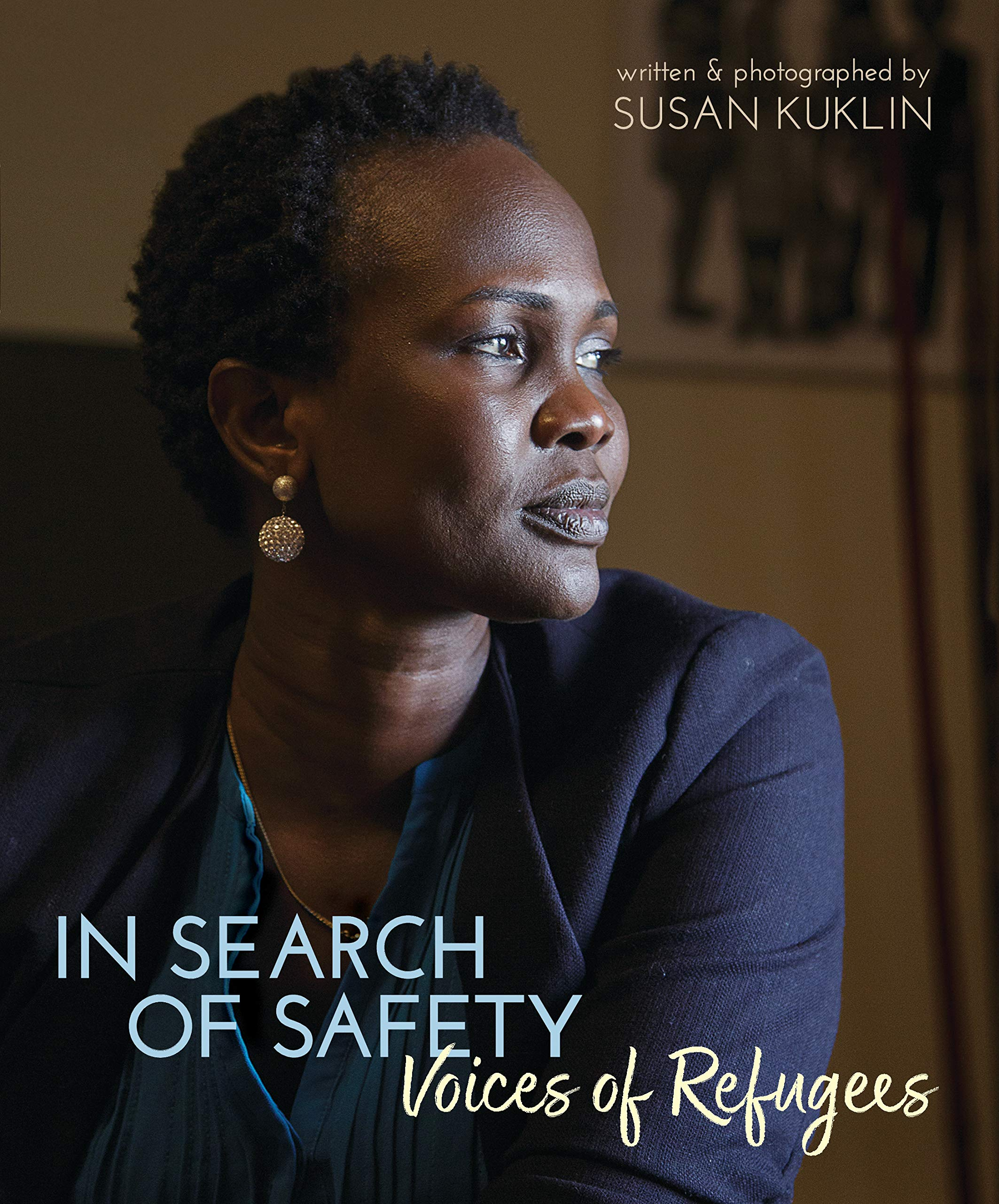 The cover of In Search of Safety, depicting a black woman staring contemplatively to the right while sitting in a brown room.