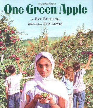 Cover of One Green Apple depicting a yong girl in a light colored hijab holding an apple with an apple orchard in the background, where other children pick apples.