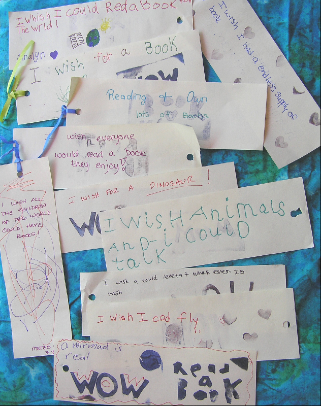 Bookmarks created by young people indicating wishes about talking to animals, desire to fly, that mermaids could be real, and to read a book to the world.